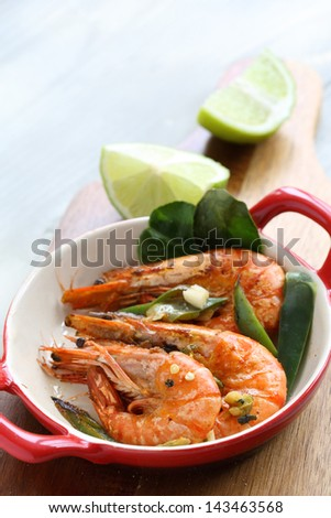 Large seared prawns/shrimp in a chili, lime and garlic glaze - stock photo