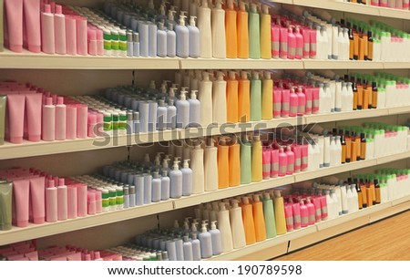 Large shelf inside retail store with cosmetic products - stock photo