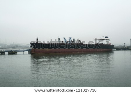 large ship docked in a harbor