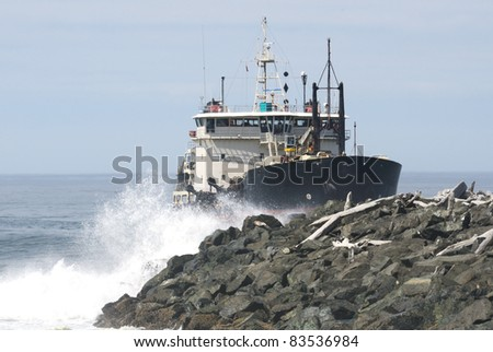 Large ship entering the entrance to the Coquille River from the Pacific Ocean