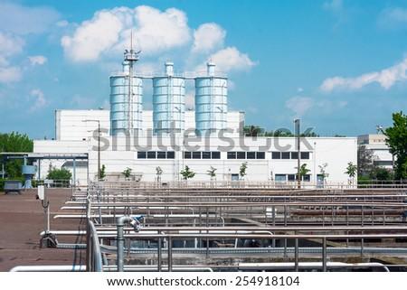Large silos outdoors under sky - stock photo
