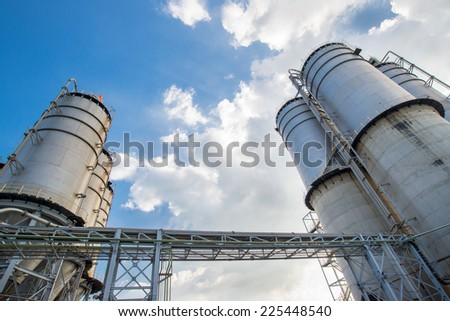Large silos under blue sky  - stock photo