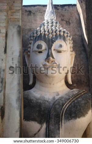 Large sitting Buddha image(Talking Buddha) , Wat Si Chum ,Sukhothai, Thailand tunnel behind Buddha image.King said through this channel and soldiers understood that buddha greeted them for win the war