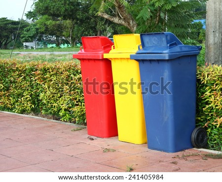Large size of plastic garbage container put on the footpath floor among daytime natural light represent the garbage recycle related idea. - stock photo