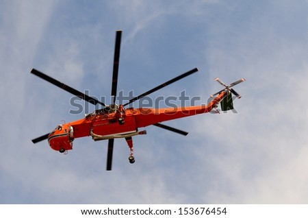 Large sky crane type helicopter lifts off from a small airport enroute to a major forest or natural cover fire in Southern Oregon on August 8th, 2013 - stock photo