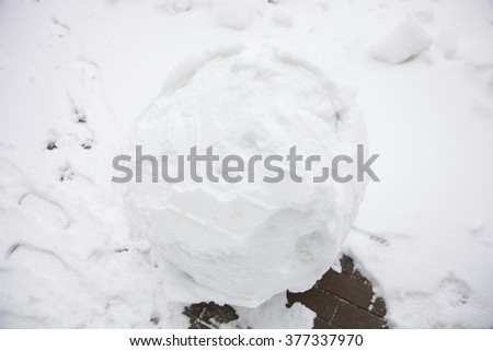 Large snowball on the road, closeup shot - stock photo