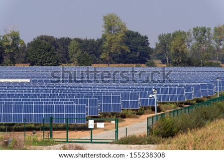 large solar panel system installed on an open field