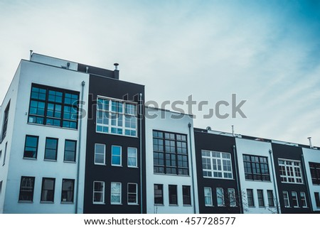 Large spacious windows on front of apartments in black and white colors under