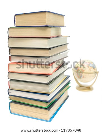 large stack of different books and globe isolated on white background - stock photo