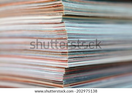 Large stack of magazines piled high texture.