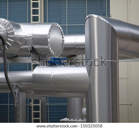 Large stainless steel pipes of an industrial air cooling system