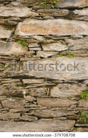 Large stone wall, front view, vertical frame.