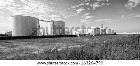 large storage tanks for oil and petrol in the amsterdam harbor area. - stock photo