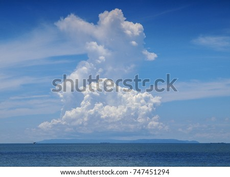 Large storm cloud rising over the ocean during the wet season near Ko Kut island in eastern Thailand