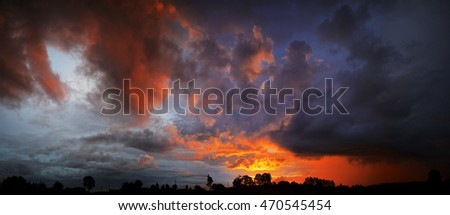 Large storm clouds over a field