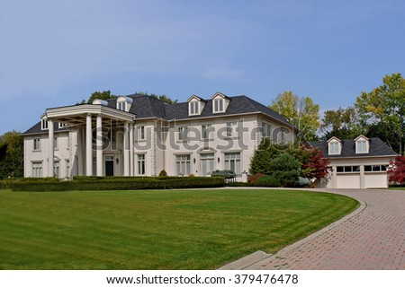 large suburban house with circular driveway