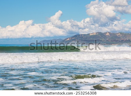 Large surf and waves breaking along the Ventura county, California coastline just south of Ventura harbor. - stock photo