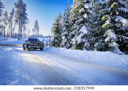 large suv, car driving in rough snowy terrain - stock photo