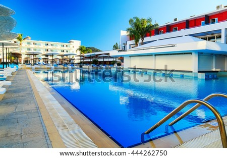 large swimming pool at resort on the shores of the Aegean Sea Greece Rhodes - stock photo