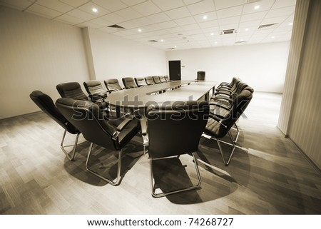 large table and chairs in a modern conference room - stock photo