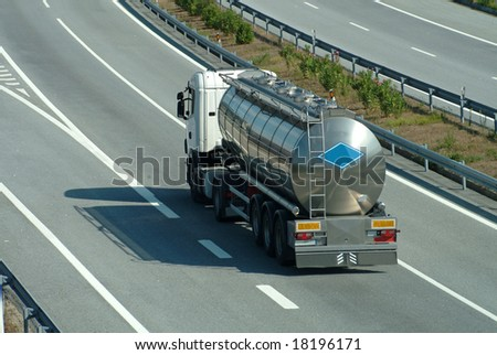 Large tanker truck rolling on highway