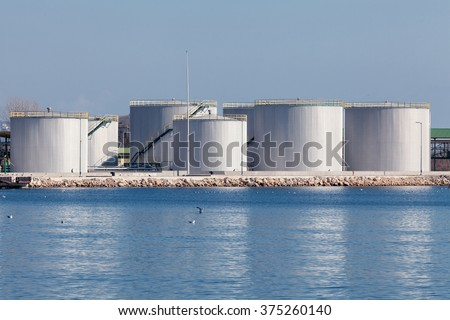 large tanks for petrol and oil, blue sky