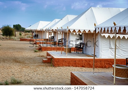 Large tents in the Indian desert - tourist camp - stock photo