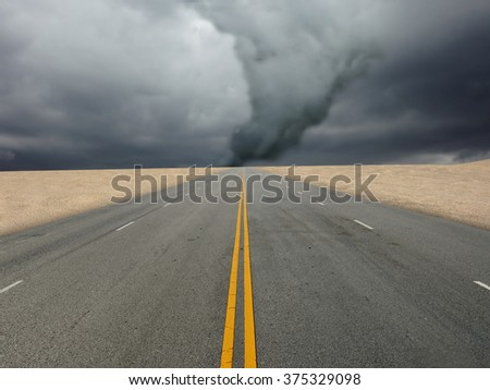 large tornado over the road - stock photo