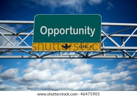 Large traffic billboard the word opportunity on it