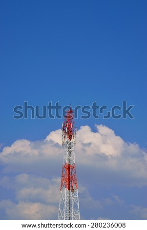 Large transmission tower against sky - stock photo