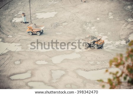 large trucks in the career top view of the far - stock photo