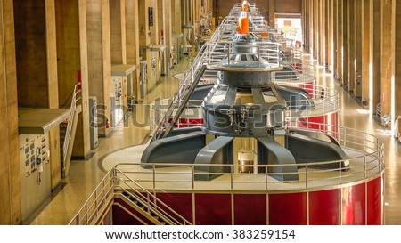 Large turbines spin to create electricity in the powerplant at Hoover Dam - stock photo