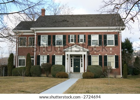 Large two story vintage Colonial style house - stock photo