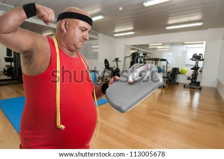 Large unhappy fitness man with weight scale in a gym - stock photo