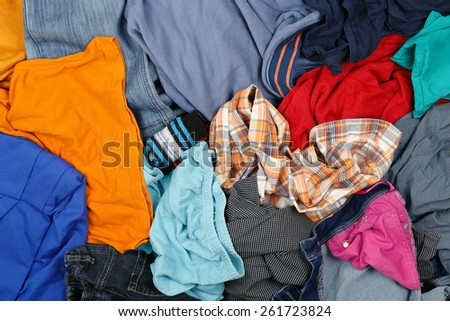 large variety of unironed clothes - stock photo