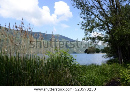 Large view of north Bourget lake and mountains from Chambotte, Savoy