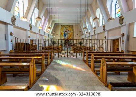 Large view on the small chapel and praying nun - stock photo
