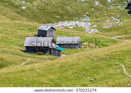 Large view on the small houses in Alps Austria - stock photo
