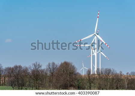 Large view on the windmills on the large field