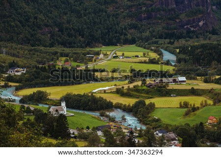 Large view over a village in a valley somewhere in Norway - stock photo
