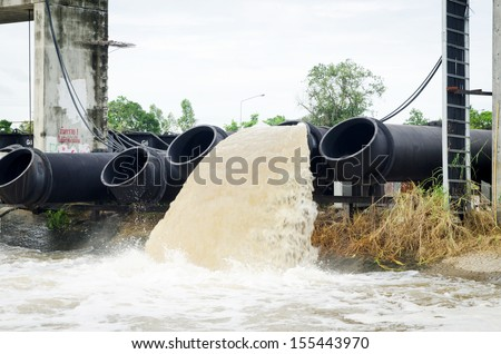 large water pipe pump flood water and drain - stock photo