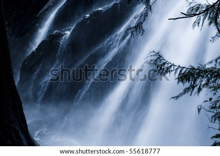 Large waterfall in western Washington flowing rapidly in the spring - stock photo