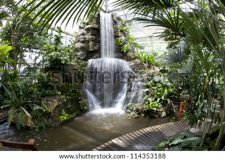 Large waterfalls, tropical gardens. - stock photo