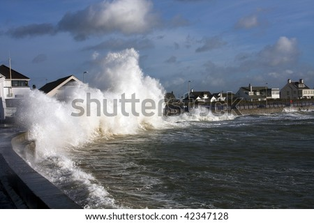 large waves hitting Trearddur bay Breakwater at high tide Isle of Anglesey North Wales