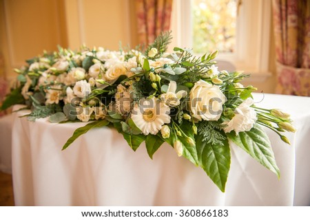 large white and cream colored flower bouquet on a table