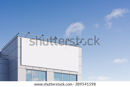 Large white billboard on the facade of building.