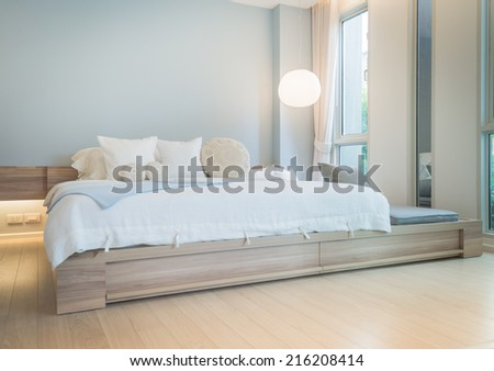 large white cozy bed in bedroom - stock photo