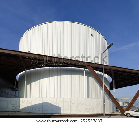 large white storage tank in the rotterdam harbor