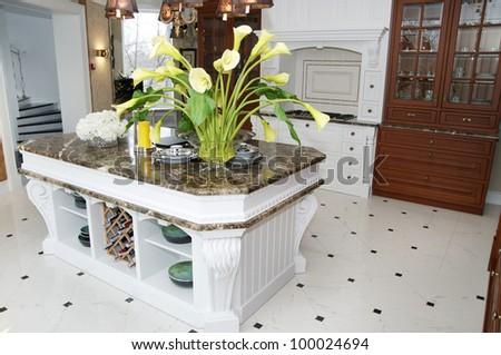 large white stylish kitchen with marble table - stock photo
