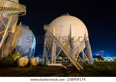large white tanks for petrol and oil at night - stock photo